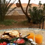 Breakfast facing the dunes from Kasbah Panorama_Source NOSADE