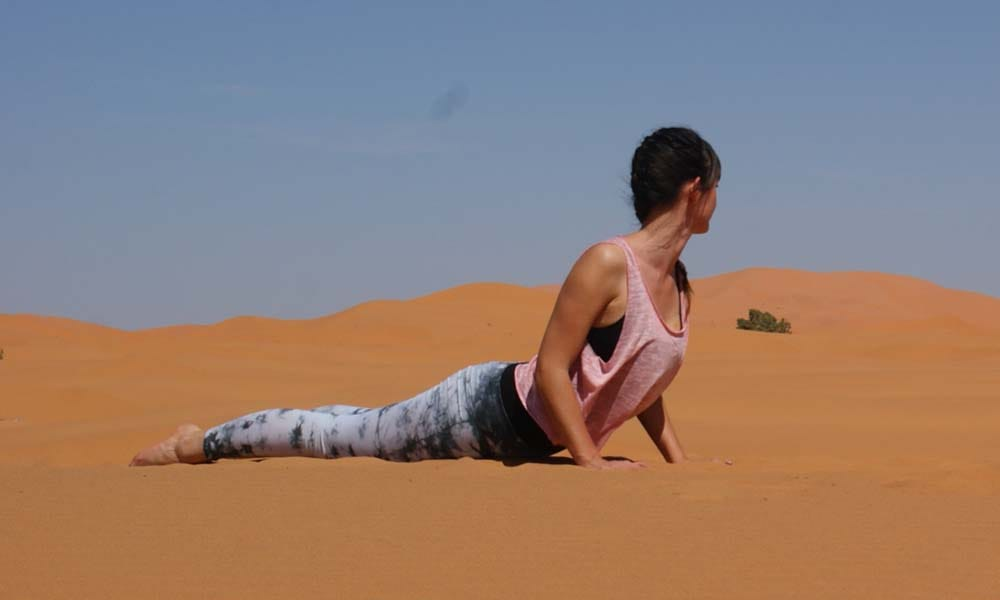 Cobra pose Yoga Sahara Desert_Source NOSADE
