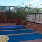 Marrakech rooftop Yoga_Source Amanda LaMagna Livaligned