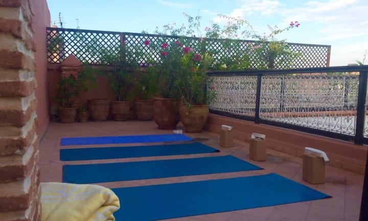 Marrakech rooftop Yoga_Source Amanda LaMagna Livaligned