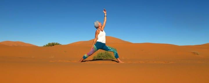 Sahara desert yoga Morocco Urdvha Virabhadrasana 2_Source NOSADE