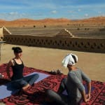 Yoga lesson facing the desert_Source NOSADE